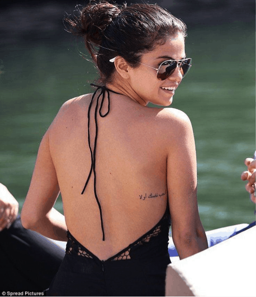 Partnered post amazing small tattoos in hollywood the for Love yourself first in arabic tattoo